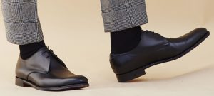 black-shoes-and-grey-trousers